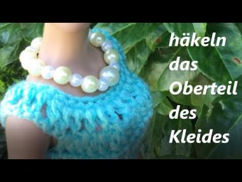 Häkeln Oberteil des Kleides für die Puppe. We crochet the top part of the dress for the doll